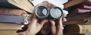 Spy glasses looking through books, I help businesses get found in search